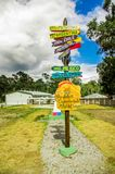 CAYAMBE, ECUADOR - SEPTEMBER 05, 2017: Informative sign of distance from Cayambe, of different countries written over a. Wooden arrow. National Park Cayambe Royalty Free Stock Photos