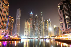 The Cayan Tower in night illumination at Dubai Marina Royalty Free Stock Image