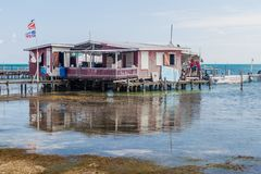 CAYE CAULKER, BELIZE - MARCH 2, 2016: Wooden house on a pier in Caye Caulker village, Beli royalty free stock images