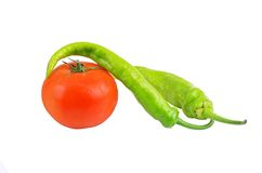 Cayenne chili pepper and tomato Royalty Free Stock Photography