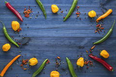 Cayenne chilli peppers, yellow habanero peppers, pepperoncini peppers and color pepper Stock Photography