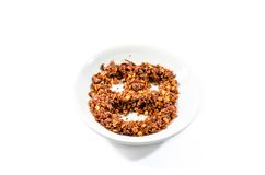 Cayenne pepper and chilli pepper in bowl on white background Stock Images