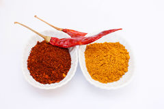 Cayenne pepper and curry powder on white background. Stock Image