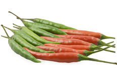 Cayenne pepper  lie opposite each other. Red and green cayenne pepper  lie opposite each other Royalty Free Stock Photography