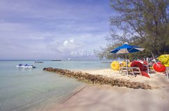 Cayman Island Beach. A great day in the Cayman Islands for boating swimming or just having fun. Paddle and ski boats Stock Photo