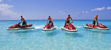 Cayman Island Water Scooters. Getting around the Cayman Island by water scooters Stock Photo
