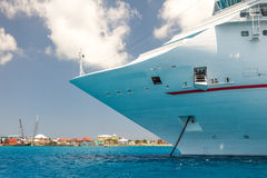 Cayman Islands. Cruise ship anchored offshore from the Caribbean island of the Cayman Islands royalty free stock photo