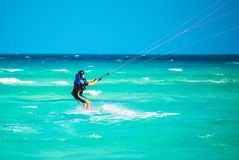 Cayo Guillermo , Cuba - 25 March 2012 : Athletes surfer involved. In sports kite windsurfing during high winds and low tide Atlantic Ocean Latin America royalty free stock photo