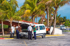 CAYO LARGO, CUBA - MAY 10, 2017: Taxi drivers at the airport. Copy space for text. Stock Photos