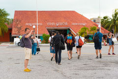 CAYO LARGO, CUBA - MAY 10, 2017: Tourists at the airport. Copy space for text. CAYO LARGO, CUBA - MAY 10, 2017: Tourists at the airport. Copy space for text Royalty Free Stock Images