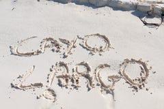 Cayo largo escrito en la arena Fotografía de archivo libre de regalías
