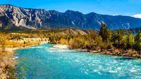 Cayoosh Creek just before it runs into the Fraser River in BC, Canada. The clear turquoise waters of the Cayoosh Creek just before it runs into the Fraser River stock photography