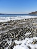 Cayuga Lake frozen waves and stone shoreline. Visited just after a sub-zero cold front passed through the area. Cayuga Lake is the longest of central New York`s royalty free stock photos