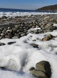 Cayuga Lake rocky frozen shoreline. Visited just after a sub-zero cold front passed through the area. Cayuga Lake is the longest of central New York`s glacial stock images
