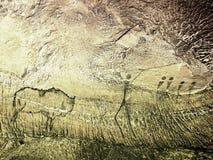Caza del búfalo Pintura de la caza humana en la pared de la piedra arenisca, imagen prehistórica Imagenes de archivo