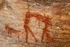 Caza del hombre. arte prehistórico de la cueva del bosquimano fotos de archivo libres de regalías