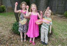 Caza del huevo de Pascua de los niños Imágenes de archivo libres de regalías