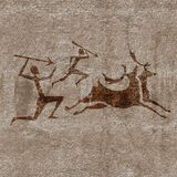 Caza prehistórica Fotos de archivo libres de regalías