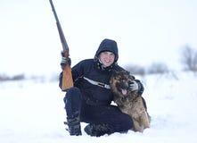 Cazador con su perro Foto de archivo