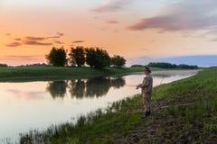 Cazador de Pike en el río Fotografía de archivo libre de regalías