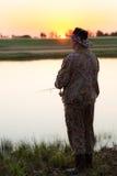 Cazador de Pike en el río Foto de archivo libre de regalías