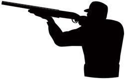 Cazador que apunta la escopeta
