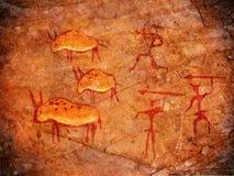 Cazadores en las pinturas de la cueva Imagenes de archivo