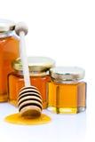 Cazo de la miel con la miel Imágenes de archivo libres de regalías