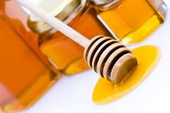 Cazo de la miel con la miel Imagenes de archivo