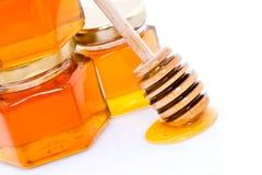 Cazo de la miel con la miel Foto de archivo libre de regalías