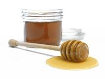 Cazo y tarro de la miel Fotografía de archivo