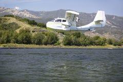 CB Amphibious seaplane landing on Lake Casitas, Ojai, California Royalty Free Stock Image