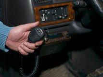 CB Car Radio. Closeup of a male hand holding a CB car radio microphone stock photos