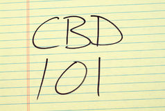 CBD 101 på ett gult lagligt block Royaltyfri Bild