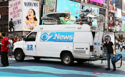 CBS News. Van with a crew member on his way to photograph in time square Royalty Free Stock Photos