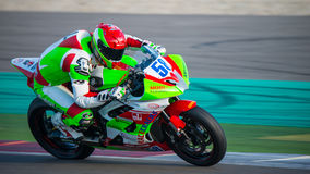 1000cc Racing on TT Assen Circuit. ASSEN, NETHERLANDS - OCTOBER 19, 2014: Competitor number 58 racing through the apex of the 1000cc superbike races on the TT Stock Photos