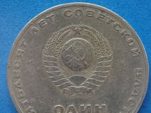 CCCP (SSSR) coin with hammer and sickle. Vintage withdrawn CCCP (SSSR) coin with Communist hammer and sickle royalty free stock photo