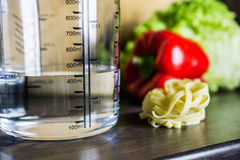 400ccm / 400ml Of Water In A Measuring Cup On A Kitchen Counter With Food Royalty Free Stock Photography