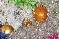 Ccolorful christmas tinsel and balls royalty free stock image