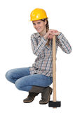CCrouching with sledge hammer Stock Images