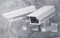 Cctv照相机或安全监控相机在水泥背景 免版税库存照片