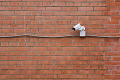 CCTV на кирпичной стене Стоковая Фотография