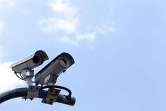 CCTV. CCTV cameras on high towers in the background sky Royalty Free Stock Image