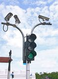 CCTV. Surveillance Security Camera or CCTV with traffic light Stock Image