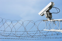 CCTV with barbed wire. Royalty Free Stock Images
