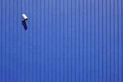 Cctv on blue. Security camera on blue metallic wall with copy space Royalty Free Stock Photo