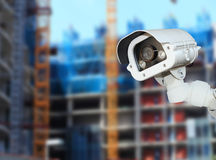 CCTV with Blurring Building construction background. Royalty Free Stock Image