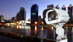 CCTV with Blurring City in night background. Stock Photo