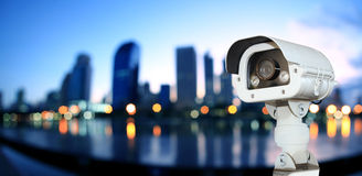 CCTV with Blurring City in night background. Stock Photos