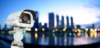 CCTV with Blurring City in night background. Royalty Free Stock Photos